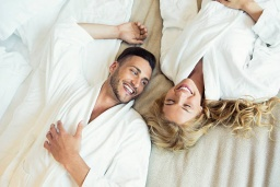 beautiful-young-couple-wearing-bath-robes-in-bed.jpg